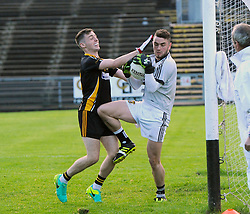 Louisburgh&rsquo;s James Dowd challenges Kilmeena goalkeeper Paul Groden during the Mayo junior semi final.<br />Pic Conor McKeown