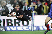 All Black wing Joe Rokocoko dives to score a try during the second international test match between the All Blacks and France at Westpac Stadium, Wellingon, on Saturday 9 June 2007. Photo: Andrew Cornaga/PHOTOSPORT<br />