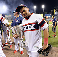 CHICAGO - JULY 26:  Melky Cabrera #53 of the Chicago White Sox celebrates with the Crosstwon Cup after the game against the Chicago Cubs on July 26, 2016 at U.S. Cellular Field in Chicago, Illinois.  The White Sox defeated the Cubs 3-0.  (Photo by Ron Vesely) Subject:    Melky Cabrera