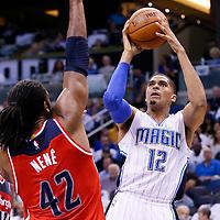 28 October 2015: Orlando Magic forward Tobias Harris (12) takes a jump shot over Washington Wizards forward Nene Hilario (42) during the Washington Wizards 88-87 victory over the Orlando Magic, at the Amway Center, in Orlando, Florida, USA.