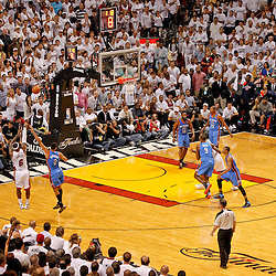 Jun 19, 2012; Miami, FL, USA; Miami Heat small forward LeBron James (6) shoots a three pointer over Oklahoma City Thunder shooting guard Thabo Sefolosha (2) during the fourth quarter in game four in the 2012 NBA Finals at the American Airlines Arena. Miami won 104-98. Mandatory Credit: Derick E. Hingle-USA TODAY SPORTS
