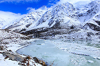 The glacial lake at the head of the Hooker Valley Trail in Mt Cook National Park offers stunning views of snow covered mountains in this spectacular part of the South Island of New Zealand