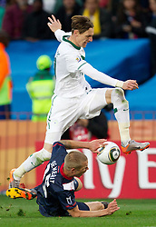 Milivoje Novakovic of Slovenia vs Jay DeMerit of USA during the 2010 FIFA World Cup South Africa Group C match between Slovenia and USA at Ellis Park Stadium on June 18, 2010 in Johannesberg, South Africa. (Photo by Vid Ponikvar / Sportida)