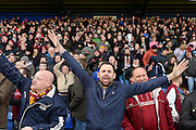 The Cobblers fans celebrate during the Sky Bet League 2 match between Mansfield Town and Northampton Town at the One Call Stadium, Mansfield, England on 28 March 2016. Photo by Jon Hobley.