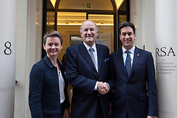 © Licensed to London News Pictures. 25/11/2013. London, UK. The shadow home secretary Yvette Cooper (L), former chief commissioner of the Metropolitan Police Service Sir John Stevens (C) and Labour leader Ed Miliband (R) stand on the doorstep of the Royal Society of Arts before the presentation of a report by the Independent Commission on the future of Policing in England and Wales, in London today (25/11/2013). Photo credit: Matt Cetti-Roberts/LNP