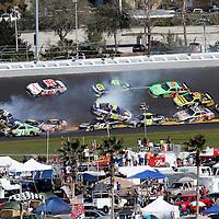 NASCAR Sprint Cup Series drivers Michael Waltrip (15), Andy Lally (71), Joe Nemechek (87) Greg Biffle (16) and David Reutimann (00) are involved in a multi car crash during the Daytona 500 at Daytona International Speedway. on February 20, 2011 in Daytona Beach, Florida. (AP Photo/Alex Menendez)