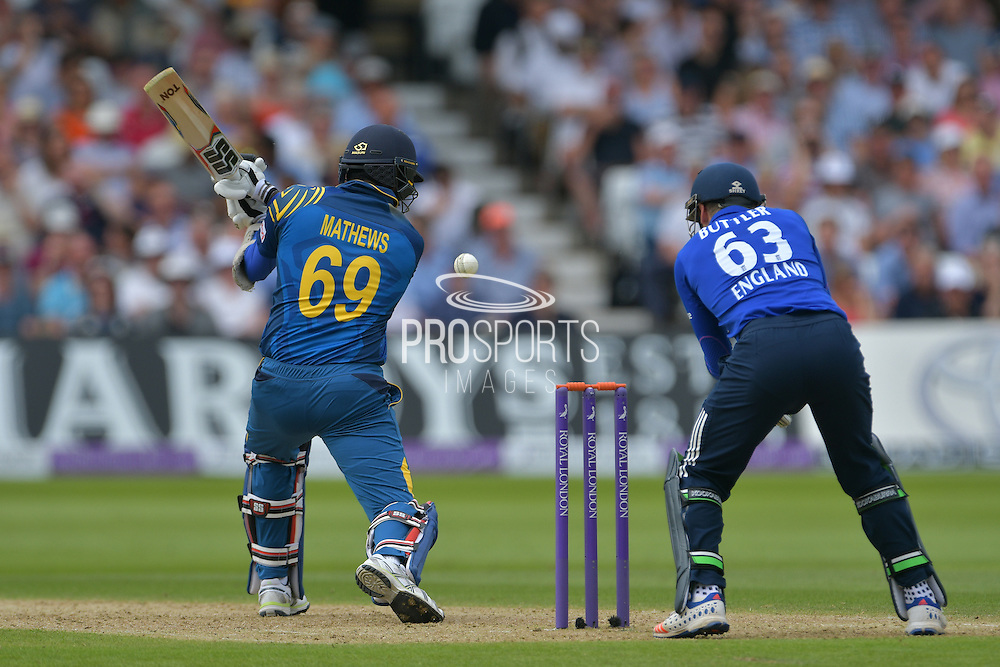 Angelo Mathews of Sri Lanka cuts into the ground of Adil Rashid of England (not shown) watched on by Jos Buttler of England during the Royal London ODI match between England and Sri Lanka at Trent Bridge, West Bridgford, United Kingdom on 21 June 2016. Photo by Simon Trafford.