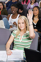 Female University student raising hand in class