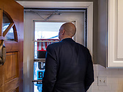 07 JANUARY 2020 - DES MOINES, IOWA: US Senator CORY BOOKER looks at the crowd waiting to hear him at a house party in Des Moines. About 75 people showed up and the event was moved outside because there were too many people to fit in the house. Sen. Booker is campaigning in Iowa to support his candidacy for the US Presidency. He cut his campaign schedule short so he could return to Washington DC for briefings about the Iran situation. Iowa traditionally holds the first event of the presidential election cycle. The Iowa caucuses are Feb. 3, 2020.          PHOTO BY JACK KURTZ