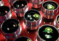 "Finshed ""lens heads"" for the Leica Noctilux-M 50mm f-0.95 ASPH. Leica claims this is the fastest aspherical lens in the world. Priced at $11,000 each, this tray of lenses represents over $100,000 of prime Leica glass. (Photo © Jock Fistick)"