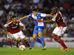 Bristol Rovers' Oliver Norburn battles for the ball with Bristol City's Marlon Harewood  - Photo mandatory by-line: Joe Meredith/JMP - Tel: Mobile: 07966 386802 04/09/2013 - SPORT - FOOTBALL -  Ashton Gate - Bristol - Bristol City V Bristol Rovers - Johnstone Paint Trophy - First Round - Bristol Derby