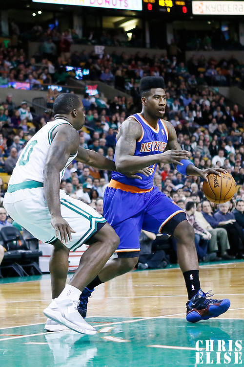 26 March 2013: New York Knicks small forward Iman Shumpert (21) drives past Boston Celtics power forward Brandon Bass (30) during the New York Knicks 100-85 victory over the Boston Celtics at the TD Garden, Boston, Massachusetts, USA.