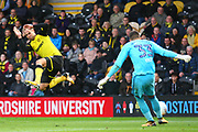 Burton Albion's Luke Varney tries to block the clearance of Ipswich Town's Bartosz Białkowski during the EFL Sky Bet Championship match between Burton Albion and Ipswich Town at the Pirelli Stadium, Burton upon Trent, England on 28 October 2017. Photo by John Potts.