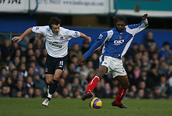 PORTSMOUTH, ENGLAND - SATURDAY, DECEMBER 9th, 2006: Kanu of Portsmouth clashes with Simon Davies of Everton during the Premiership match at Fratton Park. (Pic by Chris Ratcliffe/Propaganda)