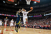 January 9, 2014: Shavon Shields (31) of the Nebraska Cornhuskers with a lay up against Glenn Robinson III (1) of the Michigan Wolverines at the Pinnacle Bank Arena, Lincoln, NE. Michigan defeated Nebraska 71 to 70.