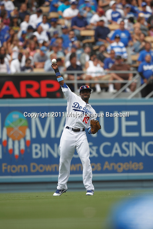 LOS ANGELES - JUNE 19:  Left fielder Tony Gwynn Jr. #10 of the Los Angeles Dodgers plays catch between innings during the game against the Houston Astros at Dodger Stadium on Sunday, June 19, 2011 in Los Angeles, California.  The Dodgers defeated the Astros 1-0.  (Photo by Paul Spinelli/MLB Photos via Getty Images) *** Local Caption *** Tony Gwynn Jr.