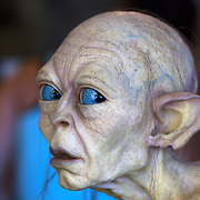 A life like figure of Lord of the Rings character Gollum at Weta Cave in  Miramar, Wellington. The Weta Cave screens a first-ever behind the scenes look at Weta and interviews with Weta co-founders Peter Jackson, Richard Taylor, Tania Rodger and Jamie Selkirk. The mini-museum, includes some of the characters, props and displays from  movies and a wide range of Weta related movie and TV merchandise..A life like figure of Lord of the Rings character Gollum, limited edition sculptures, hand-crafted by the artists at Weta, collectibles,. unique Weta designed clothing, jewellery and mementoes.. Weta Cave. Wellington, New Zealand, 25th January 2011.  Photo Tim Clayton.