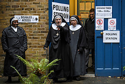 © Licensed to London News Pictures. 12/12/2019. London, UK. A group of nuns leave a polling station at St John's Hyde Park church in Bayswater, West, London after casting their vote on polling day of the 2019 General Election. A general election was called for December 12th following a deadlock in Parliament over the UK's decision to leave the EU. Photo credit: Ben Cawthra/LNP