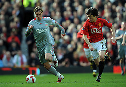 Fernando Torres of Liverpool takes on Ji Sung Park of Manchester United during the Barclays Premier League match between Manchester United and Liverpool at Old Trafford on March 14, 2009 in Manchester, England.