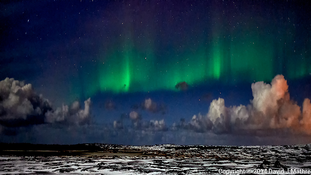 Reykjavik Northern Lights. Image taken with a Nikon Df camera and 24 mm f/1.4 lens (ISO 1600, 24 mm, f/1.4, 1 sec).