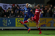 AFC Wimbledon midfielder Mitchell (Mitch) Pinnock (11) battles for possession with Gillingham defender Connor Ogilviei (6) during the EFL Sky Bet League 1 match between AFC Wimbledon and Gillingham at the Cherry Red Records Stadium, Kingston, England on 23 November 2019.