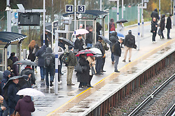 © Licensed to London News Pictures. 07/12/2018. Pettswood, UK. London commuters brave the cold,wet and windy weather at Pettswood train station,Pettswood this morning .Photo credit: Grant Falvey/LNP