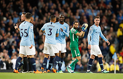 Manchester City's Yaya Toure celebrates with team-mates as he leaves the pitch during the Premier League match at the Etihad Stadium, Manchester.