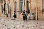 Israel , Jerusalem the narrow alleyway of the Jewish Mea Shearim neighbourhood, young children playing in the street