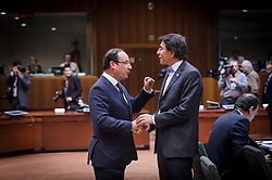 Francois Hollande, France's president, left, speaks with Elio Di Rupo, Belgium's prime minister, during the first day of the EU Summit, at the European Council headquarters in Brussels, Belgium on Thursday, Dec. 13, 2012. (Photo © Jock Fistick)