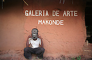 Southern Africa. Mozambique. Namupla. Gallery of Makonde Arts. Man wearing Makonde mask..DVD0016