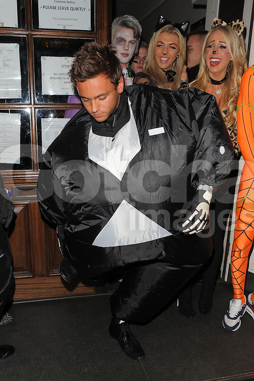 Liam Payne of One Direction dressed as Batman and Tom Daley in a fat skeleton costume at a Halloween party at the Funky Buddha nightclub in Mayfair, London, UK. 27/10/2012<br />BYLINE MUST READ : GOTCHAIMAGES.COM<br /><br />Copyright by &copy; Gotcha Images Ltd. All rights reserved.<br />Usage of this image is conditional upon the acceptance <br />of Gotcha Images Ltd, terms and conditions available at<br />www.gotchaimages.com