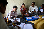 Pooja, 14, a student from the village of Pathpuri, Hoshangabad, Madhya Pradesh, India, taking part to the children's journal, a project launched by Dalit Sangh, an NGO which has been working for the uplift of scheduled castes for the past 22 years, is engaging in a meeting and discussion with the project teacher and other young members. Dalit Sangh is working in collaboration with Unicef India to promote education and awareness within backward communities.