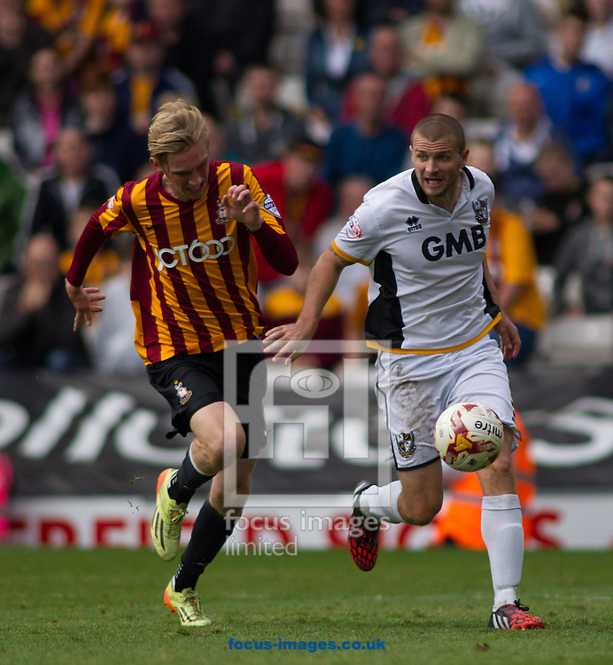 Oliver McBurnie (L) of Bradford City tackles Carl Dickinson (Captain) (R) of Port Vale during the Sky Bet League 1 match at the Coral Windows Stadium, Bradford<br /> Picture by Stephen Gaunt/Focus Images Ltd +447904 833202<br /> 27/09/2014