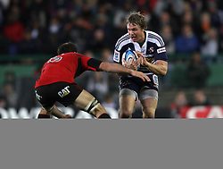 Stormers centre Jean de Villiers attempts to get past Crusaders lock Sam Whitelock during the Super Rugby Semi-Final match between DHL Stormers and the Crusaders held at DHL Newlands Stadium in Cape Town, South Africa on 2 July 2011...Photo by Shaun Roy / Sportzpics.net