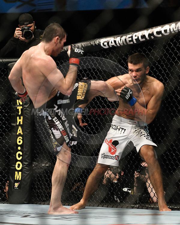 OBERHAUSEN, GERMANY, NOVEMBER 13, 2010: Amir Sadollah and Peter Sobotta during UFC 122 inside the Konig Pilsner Arena in Oberhausen, Germany.
