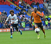 Benik Afobe leads the race for the ball from Lawrie Wilson  during the Sky Bet Championship match between Bolton Wanderers and Wolverhampton Wanderers at the Macron Stadium, Bolton, England on 12 September 2015. Photo by Mark Pollitt.