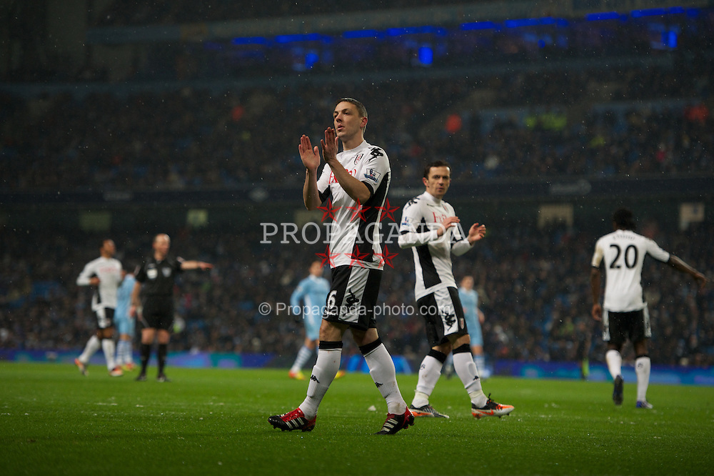 LONDON, ENGLAND - Sunday, February 04, 2012: Fulham's Chris Baird applauds the assistant referee during the Premiership match at the Etihad Stadium. (Pic by Chris Brunskill/Propaganda)