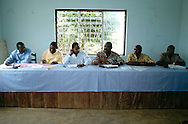 The first meeting of its kind bringing together local governmental and NGO representatives to discuss issues affecting local communities such as health education and conservation management.  From left: Louis Ngono, Collaboration Management Officer, Jengi Project-WWF; Gervais Bandgadui, Technical Assistant-GTZ (German governmental organisation doing technical social and economic studies);  the Mayor of Moloundu;  Jean-Claude Ndo, Divisional Delegate of MINEF (Ministry of Forestry and Environment).