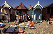 A family enjoy a hot day in their beach hut on the seafront at Southend, on 29th July 2002, in Southend-on-Sea, Essex, England.
