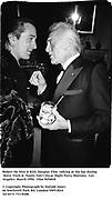 Robert De Niro & Kirk Douglas Film talking at the bar during  Steve Tisch &  Vanity Fair's Oscar Night Party,<br />Mortons,  Los Angeles. March 1994.  Film 94560/8<br /> <br />© Copyright Photograph by Dafydd Jones<br />66 Stockwell Park Rd. London SW9 0DA<br />Tel 0171 733 0108.
