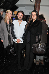 Left to right, VANESSA WURM, ADAM WAYMOUTH and LAUREN MEZZINA at a private view of art works by Annie Morris entitled 'There is A Land Called Loss' held at Pertwee Anderson & Gold Gallery, 15 Bateman Street, London W1 on 2nd February 2012.