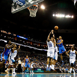 January 24,  2011; New Orleans, LA, USA; New Orleans Hornets power forward David West (30) blocks a shot by Oklahoma City Thunder point guard Russell Westbrook (0) during the third quarter at the New Orleans Arena. The Hornets defeated the Thunder 91-89. Mandatory Credit: Derick E. Hingle