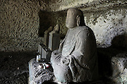 old weathered Buddhist monument in a Yagura Japan