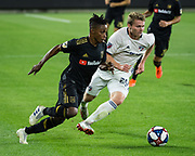 LAFC forward Latif Blessing (7) and FC Dallas defender John Nelson (26) in action during a MLS soccer match against the FC Dallas in Los Angeles, Thursday, May 16, 2019. LAFC defeated FC Dallas 2-0.  (Ed Ruvalcaba/Image of Sport)
