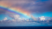 Rainbow and squall over the Pacific Ocean, Hanalei, Kauai, Hawaii USA