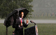 U. S. President Barack Obama speaks at a Memorial Day ceremony at Abraham Lincoln National Cemetery in Elwood, Illinois on May 31, 2010. A driving thunderstorm forced a halt of the ceremony.  (UPI)