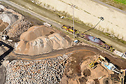 Nederland, Noord-Holland, IJmuiden , 09-04-2014; IJmuiden Steel Works van Tata Steel. Rijdende menger (torpedowagen) met vloeibaar ruw ijzer.<br /> IJmuiden Steel Works, part of Tata Steel. <br /> luchtfoto (toeslag op standard tarieven);<br /> aerial photo (additional fee required);<br /> copyright foto/photo Siebe Swart