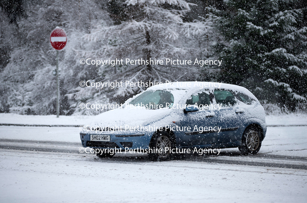 A snow lcovered vehicle crosses the A9 north of Bruar and Calvine today near Trinafour as the first serious snowfall of the winter hits Perthshire...07.12.14<br /> Picture by Graeme Hart.<br /> Copyright Perthshire Picture Agency<br /> Tel: 01738 623350  Mobile: 07990 594431