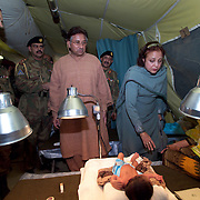 Pakistani Presedent Pervez Musharraf visits the U.S. M.A.S.H. and offers his prayers and money to the patients here.  <br /> Baby Bilal Nasir and his parents came to the U.S. M.A.S.H. in Muzaffarabad for medical treatment.<br /> The father, Nasir Kahn, said the visit by President Musharraf was &quot;a dream come true.&quot;