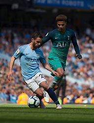 Bernardo Silva of Manchester City (L) and Dele Alli of Tottenham Hotspur in action - Mandatory by-line: Jack Phillips/JMP - 20/04/2019 - FOOTBALL - Etihad Stadium - Manchester, England - Manchester City v Tottenham Hotspur - English Premier League
